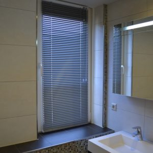 Vernieuwen badkamer met glasmozaïek